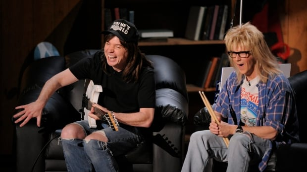 Mike Myers, seen here with Dana Carvey in a recreated scene from Wayne's World, says he proudly kept his Canadian accent while playing a character who was supposed to be from a Chicago suburb.