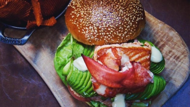 Yew Seafood Bar's take on a Canadian burger includes wild Pacific salmon, an entire lobster tail and Canadian back bacon.