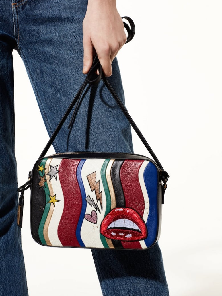 1. This crossbody is perfect for concerts with its  70s rock n roll look 40a716b905c03