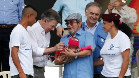 Colombian government, FARC rebels mark disarmament with ceremony