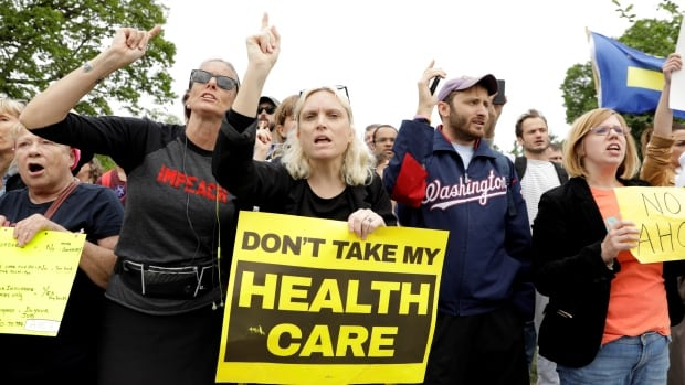 Demonstrators protest in front of the U.S. Capitol after the U.S. House of Representatives approved a bill to repeal major parts of Obamacare.
