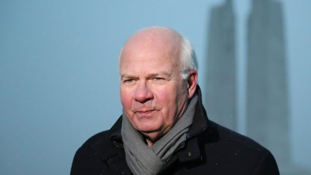 Peter Mansbridge, seen visiting the Vimy Memorial in France, will officially sign off as chief correspondent of The National during Saturday's Canada Day coverage. Viewers of The National on Thursday will see an extensive video  recap of Mansbridge career highlights.