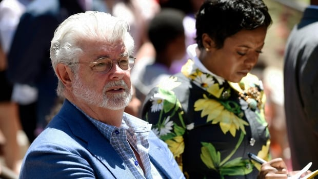 Filmmaker George Lucas, left, and his wife Mellody Hobson listen to remarks at a news conference outside Los Angeles City Hall on Tuesday, June 27, 2017. The Los Angeles City Council approved preliminary steps that will allow construction of the $1.5 billion Lucas Museum of Narrative Art in Exposition Park in Los Angeles.
