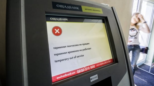 An 'out of service' notice sits on the screen of an ATM at a state bank in Kiev, Ukraine, after a ransomware virus infected its computer systems in June.