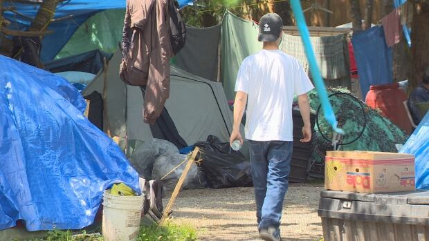 A man walks through the Anita's Place homeless camp, which was established in May, 2017 following the closure of the Rain City shelter.