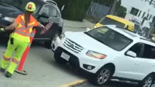 Bystander video shows the moments before a construction flagger was hit by an SUV in Burnaby, B.C., on June 28, 2017.