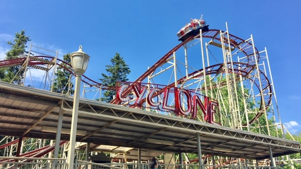 A Moncton man says he and his son were stuck at the top of the Cyclone rollercoaster for half an hour Tuesday night. He says no safety harnesses were used to evacuate them.