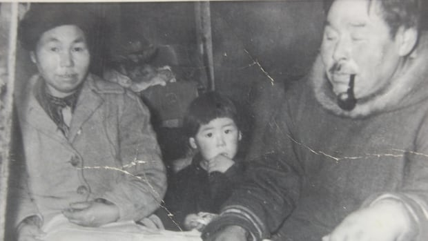 A three-year-old Larry Audlaluk with his mother and father at their new home in what is now Grise Fiord, Nunavut. The forced relocation was very difficult for his family — his mother was constantly crying, he says, and his father died ten months after moving.