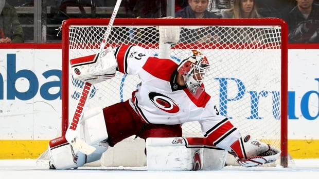 The Calgary Flames have reportedly acquired goaltender Eddie Lack, above, and defenceman Ryan Murphy from the Carolina Hurricanes.