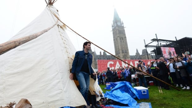 Prime Minister Justin Trudeau leaves a teepee on Parliament Hill in Ottawa June 30 after meeting with Indigenous activists. Canada's treatment of Indigenous people will figure prominently when a government delegation goes before a UN committee to defend Canada's record on human rights.