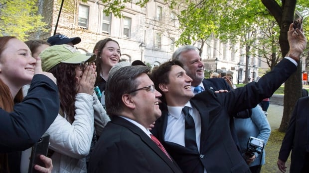 Prime Minister Justin Trudeau takes a selfie with Montreal Mayor Denis Coderre and Quebec Premier Philippe Couillard on Montreal's 375th anniversary.