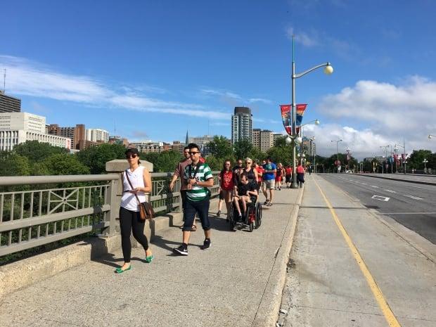 STO buses pedestrians Portage Bridge July 1 2017