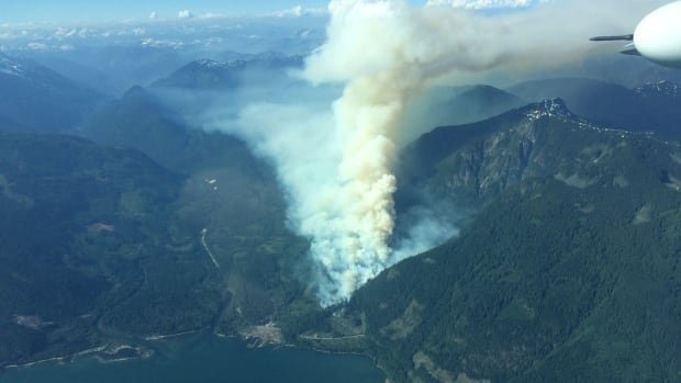 A fire near Harrison Lake, B.C., has tripled in size since Saturday, when this photo was taken.
