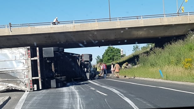 Photo taken from inside a car blocked by the transport truck that rolled over on Highway 427 Monday morning (Provided by Tiffany Sokyrko).