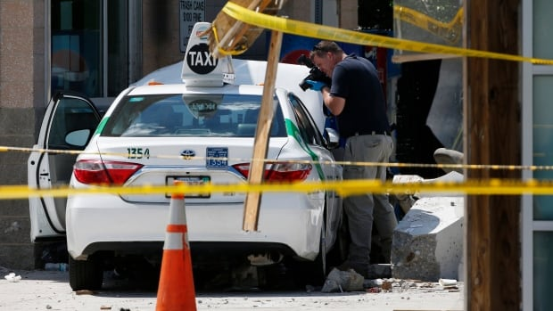 Police say a taxi driver struck a group of pedestrians outside Boston's Logan International Airport. A police official said the crash is not believed to be intentional.