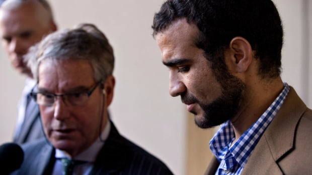 A government source has confirmed to CBC News that Ottawa will apologize and pay $10.5 million in compensation to former Guantanamo Bay prisoner Omar Khadr, right.