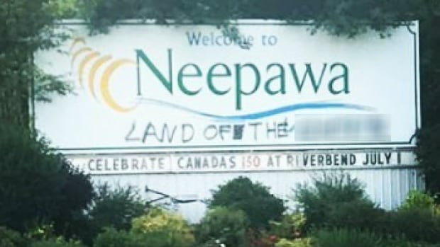 The welcome sign in Neepawa, Man., was painted with a racial slur, blurred by CBC News, over the long weekend.