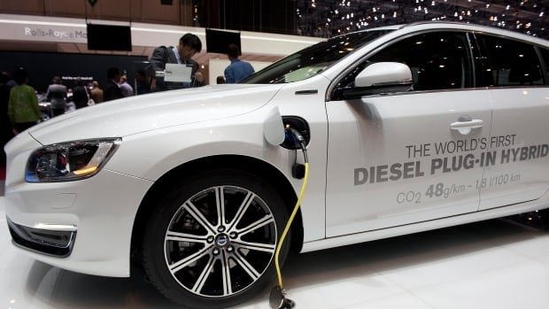 A Volvo hybrid car is shown at the Geneva International Motor Show in March 2013. The company says all its car models launched after 2019 will be electric or hybrids.