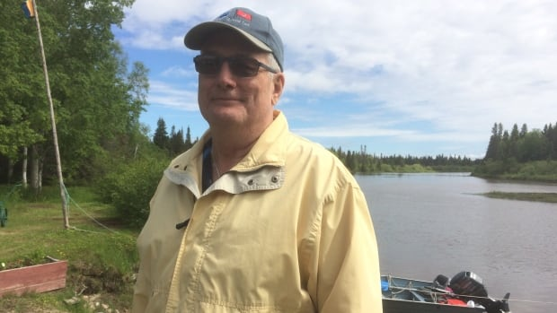 Dave Raeburn stands on his lawn in Mud Lake. When the Churchill River jammed, his entire property was submerged and his basement flooded.
