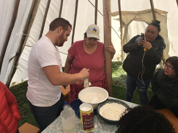 C3 staff Emmett MacDougal and participants learn to make bannock