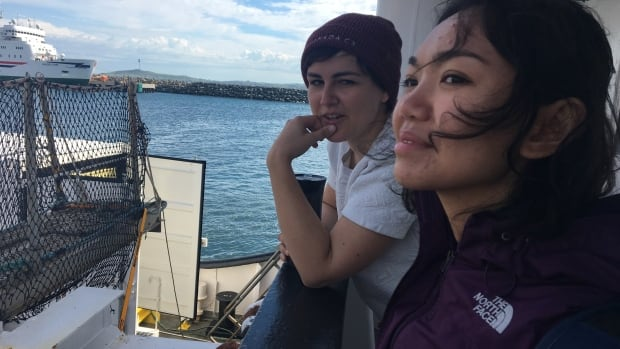 Emma Berthou and Khairunnisa Intiar are pictured aboard the C3 ship, the Polar Prince, off Quebec's Magdalen Islands.