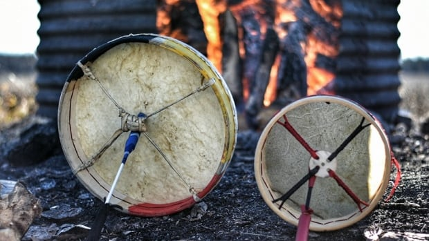 Drums being warmed prior to a sweat lodge ceremony.