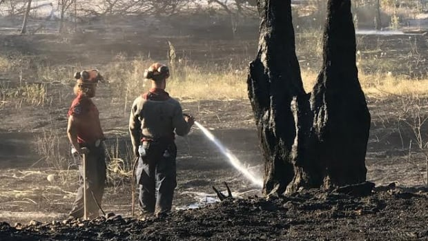 Firefighters put out smouldering hot spots on Wednesday morning in Kaleden, after a wildfire triggered an evacuation on Tuesday afternoon.