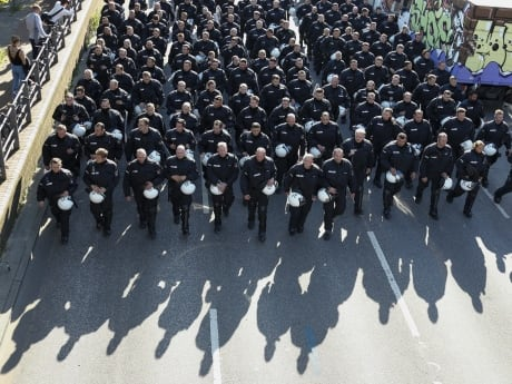 German riot police line up along a street before a demonstration during the G20 summit.