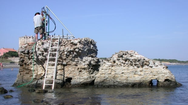 ROMACONS drilling at a marine structure in Portus Cosanus, Tuscany in 2003. ROMACONS helped provide information on ancient concrete for Marie Jackson's research.