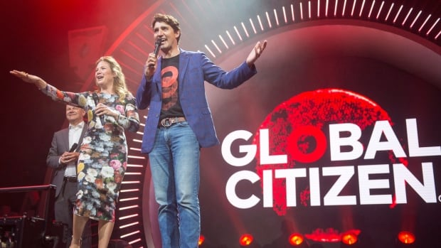 Prime Minister Justin Trudeau and his wife Sophie Gregoire Trudeau introduce Coldplay to open the Global Citizen concert at the G20 summit in Hamburg, Germany Thursday.