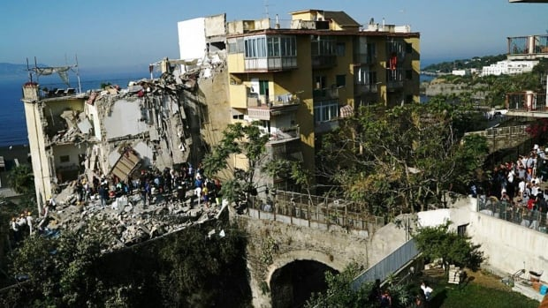 Eight missing in Italy apartment block collapse