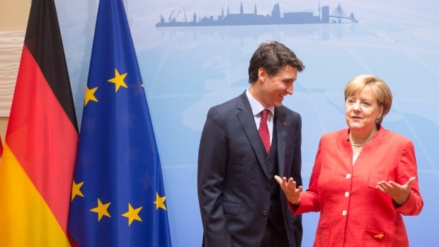 German Chancellor Angela Merkel talked about Prime Minister Justin Trudeau's family in front of the cameras Friday morning. The pair then met behind closed doors to strategize ahead of the start of the G20 summit in Hamburg.