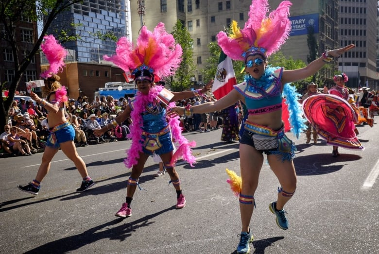 Marchers Dance During The Calgary Stampede Parade In Calgary Jeff Mcintosh Canadian Press