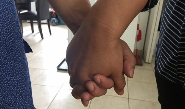 el salvador refugee with husband