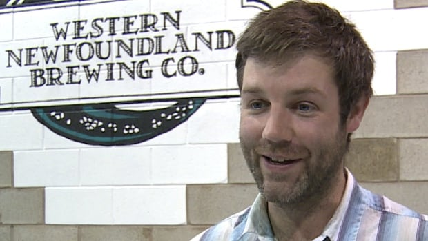 Jim Macdonald brews the new spruce beer and says it has a refreshing sweet taste.
