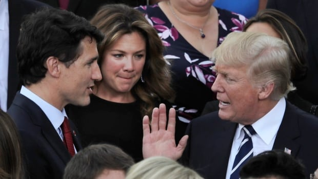 U.S. President Donald Trump talks to Prime Minister Justin Trudeau, and Sophie Gregoire-Trudeau prior to a concert on the first day of the G-20 summit in Hamburg, Friday.