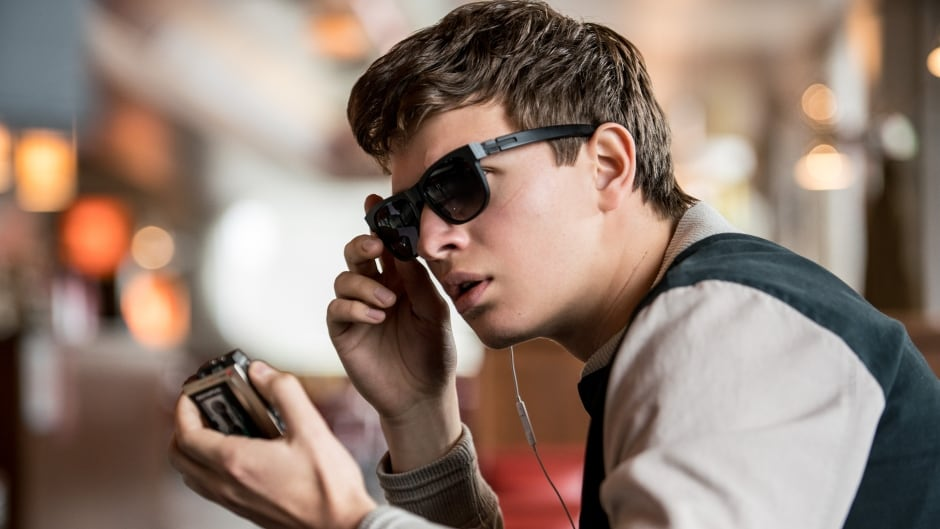 Baby, played by Ansel Elgort, listens to music while driving as a remedy for tinnitus. Music is core to the film's story line.