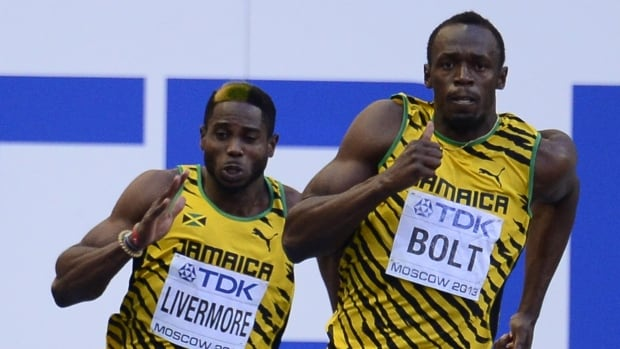 Jamaican sprinter Jason Livermore, left, (seen in this 2013 file photo running alongside countryman Usain Bolt at the IAAF World Championship) could face a four-year ban after testing positive for a banned substance  in December.