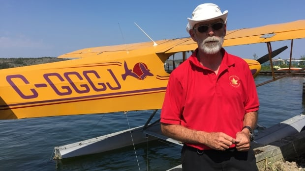 Dave Jackson stands near his float plane at the dock in Yellowknife. He estimates he spent 24 hours flying from Kingston, Ont., to the North.