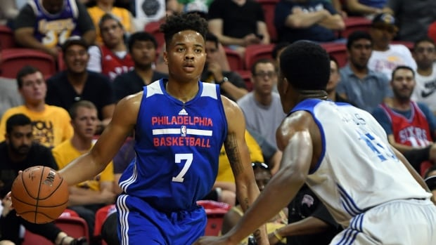Markelle Fultz helped off court after suffering apparent leg injury
