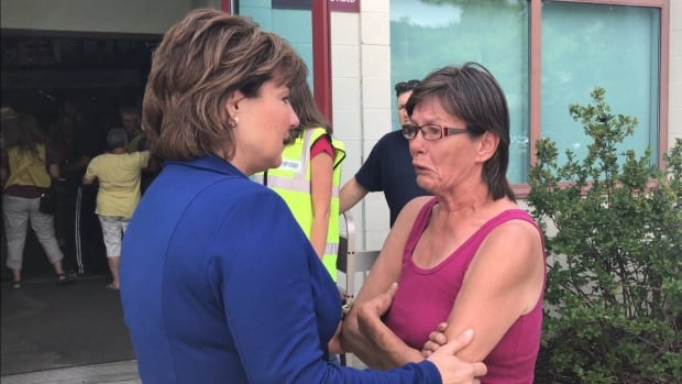B.C. Premier Christy Clark speaks with a woman from the Ashcroft Indian Band whose home was destroyed in a wildfire.