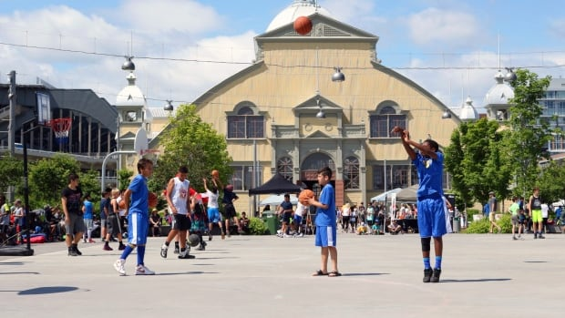 Players warm up ahead of a 3-on-3 basketball tournament held July 9, 2017, at Lansdowne Park in Ottawa.