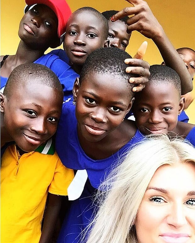 Kaylyn Kyle with young boys in Ghana