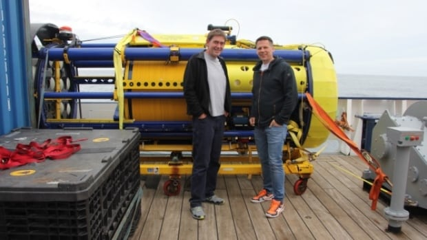 The SeaCycler has sensors that measure oxygen, carbon dioxide, nutrients, salinity and temperature. Here, Greg Siddall and Oliver Zielinski stand in front of the cylindrical sensor.