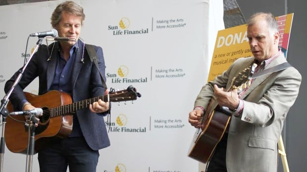 Blue Rodeo frontman Jim Cuddy joined musician Bob Egan at the Kitchener Public Library during Monday's launch of a new instrument lending program. Egan, KPL's manager of community development, said 150 instruments including hand drums, guitars and keyboards will be available to be loaned out.