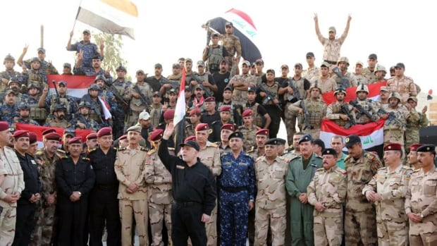 Iraqi Prime Minister Haider al-Abadi declares Mosul's liberation from ISIS control on July 10. As Iraq transitions from military to police control, Canada has decided to increase its police-trainer contingent to 20, CBC News has learned.