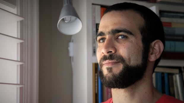 Former Guantanamo Bay prisoner Omar Khadr, 30, is seen at a home in Mississauga, Ont., last week. The federal government has paid Khadr $10.5 million and apologized for violating his rights during his long ordeal after capture by U.S. forces in Afghanistan in July 2002.