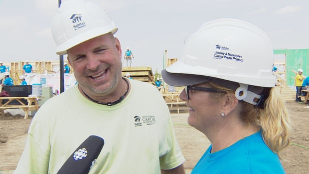Country music superstars Garth Brooks and Trisha Yearwood work on the 34th Jimmy and Rosalynn Carter Work Project with Habitat for Humanity in southeast Edmonton on Monday.