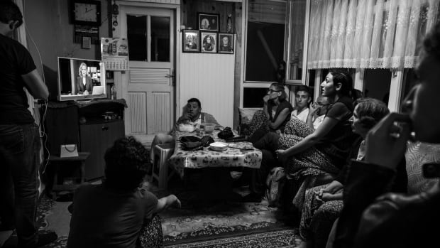 A family in Turkey watches the attempted military coup unfold on the state television network TRT on July 15, 2016.