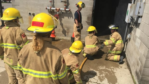 Twenty young women take part in a five day fire skills camp hosted by the London Fire Department.